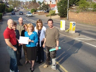 Eleanor Laing MP receives a petition concerning the state of the road in Loughton Way from local resident Dominic Harris